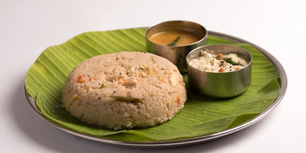 godhuma rava upma with sambar and coconut chutney served in a banana leaf on white background