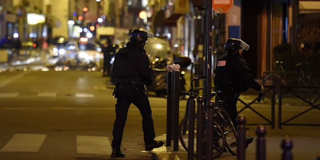 Policemen patrol near the Bataclan Theatre, one of the site of the attacks in Paris on November 15, 2015.