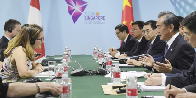 China's Foreign Minister Wang Yi, second right, and Canada's Foreign Minister Chrystia Freeland at a bilateral meeting on the sidelines of the 51st ASEAN Foreign Ministers Meeting in Singapore, Aug. 3, 2018.