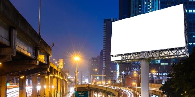 Blank billboard near expressway at night for advertisement.