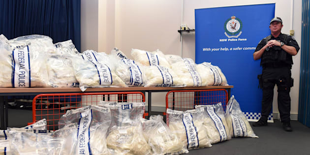 An Australian Federal Police officer stands guard over some of the seized drugs in one of the largest drug busts in the country's history, worth up to $1.28 billion USD, in Sydney on November 29, 2014.