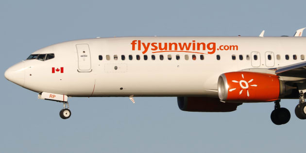 A Boeing 737-800 jetiner belonging to Canadian carrier Sunwing Airlines lands in Calgary, Alta., July 21, 2016. The Canadian Transportation Agency says it islaunching an inquiry into some mid-April Sunwing Airlines flights after receiving more than 80 complaints from passengers.