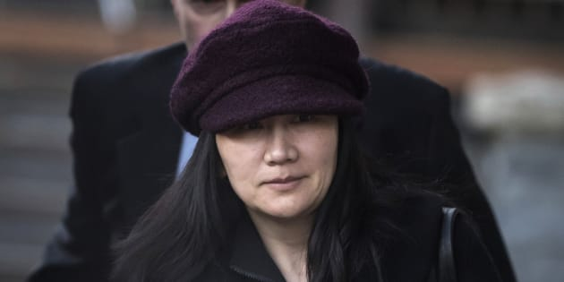 Meng Wanzhou leaves her home to attend a court appearance in Vancouver over the summer.