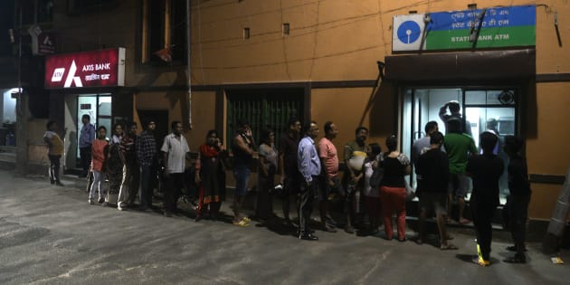 People rush to ATM machines to collect money after the declaration that Rs 500 and Rs 1000 currency notes will be demonetised.