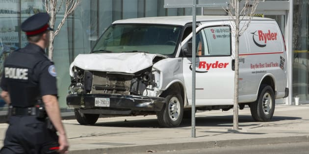 A rented van sits on a sidewalk about a mile from where several pedestrians were injured in northern Toronto, Ont. on April 23, 2018.