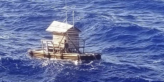 In this undated photo released by Indonesian Consulate General in Osaka, 18-year-old Aldi Novel Adilang is seen on a wooden fish trap floating in the waters near the island of Guam.