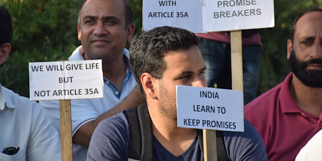 PRATAB PARK, SRINAGAR, INDIA - 2017/08/17: Civil society of Kashmir hold a sit protest at press colony Srinagar against the proposed removal of Article 35A.