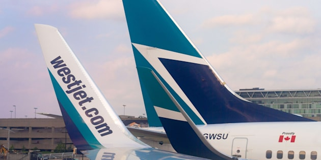 The tails of Westjet airliners at Pierre Elliott Trudeau Airport in Montreal. WestJet says it is delaying the launch of its new low-cost airline.