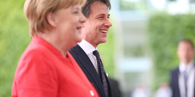 WILLY-BRANDT-STRA� 1, 10557 BERLIN, BERLIN, BERLIN-TIERGARTEN, GERMANY - 2018/06/18: Chancellor Angela Merkel welcomes the new Italian Prime Minister Guiseppe Conte with military honors in the Federal Chancellery. The photo shows Angela Merkel and Guiseppe Conte in the courtyard of the Federal Chancellery. (Photo by Simone Kuhlmey/Pacific Press/LightRocket via Getty Images)