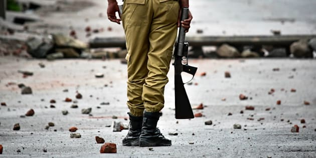 SRINAGAR, J&K, INDIA - 2018/05/08: An Indian policeman stands still during clashes in Srinagar, Indian administered Kashmir.