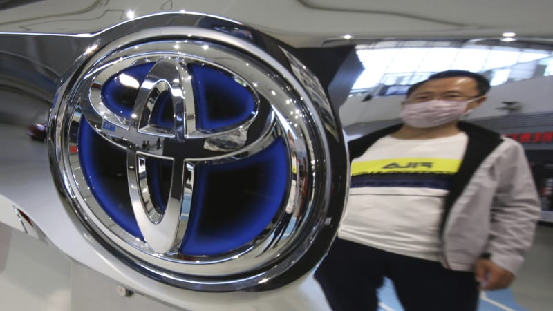 Toyota raises annual forecast after it quadruples its quarterly profit