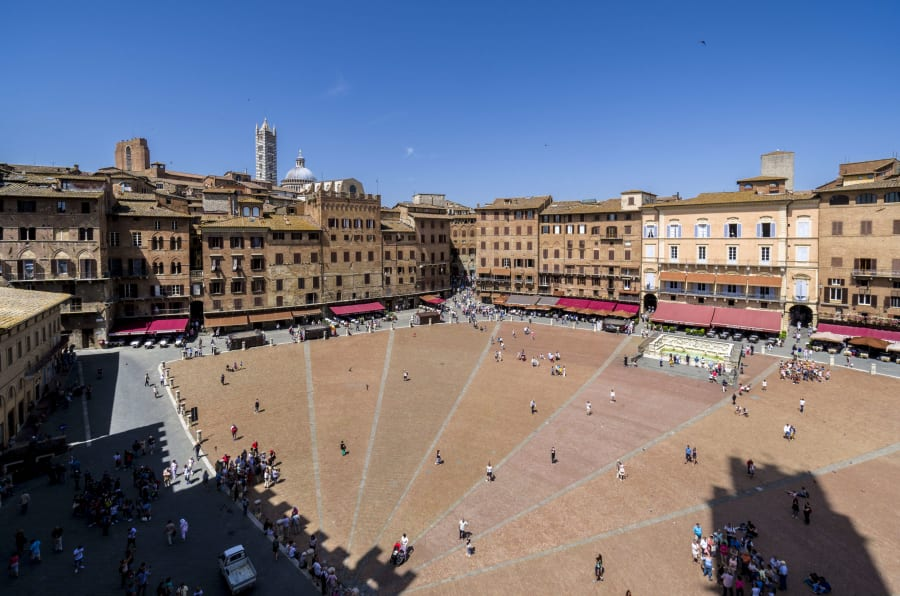 SIENA, TUSCANY, ITALY - 2016/05/27: View on the Piazza del Campo and surrounding buildings, seen from the Palazzo Pubblico. (Photo by Frank Bienewald/LightRocket via Getty Images)