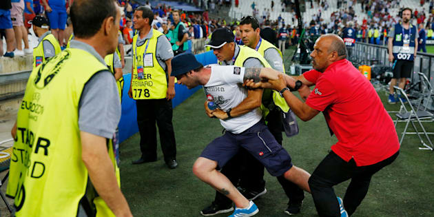 Football Soccer - England v Russia - EURO 2016 - Group B - Stade V?lodrome, Marseille, France - 11/6/16 A fan is restrained by security after the game REUTERS/Yves Herman Livepic