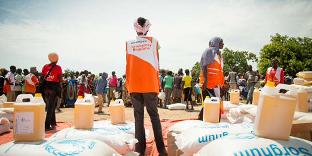 World Vision aid workers supervise food aid at Bidibidi refugee settlement in Uganda.