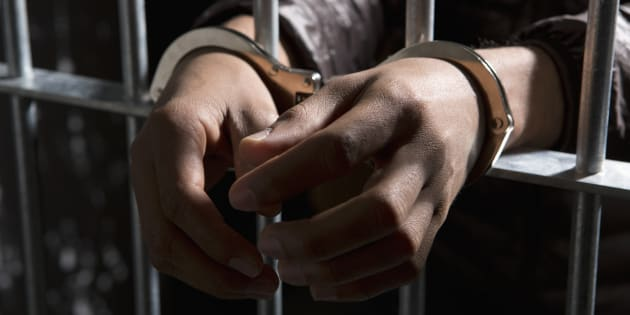 An inmate is shown in prison in a stock photo.