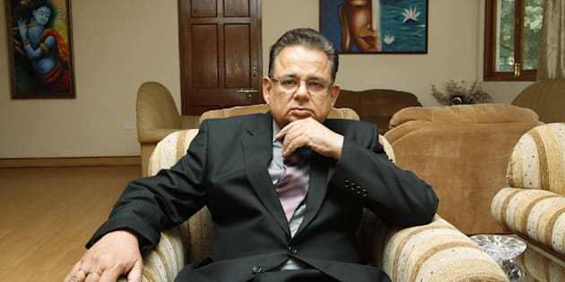Justice Dalveer Bhandari poses at his residence during an  iInterview on May 13, 2012 in New Delhi, India.