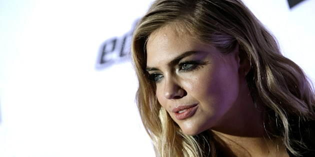 Model Kate Upton poses for photographers at a launch event for the 2017 Sports Illustrated Swimsuit Issue in New York City, Feb.16, 2017. Guess Inc shares fell more than 17 percent on Thursday following a tweet by model and actress Kate Upton accusing the company's co-founder of using his power to harass women.