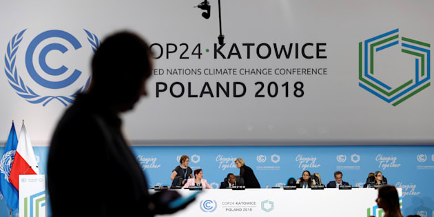 A participant's shilouette is seen during the COP24 UN Climate Change Conference 2018 in Katowice, Poland December 2, 2018. REUTERS/Kacper Pempel