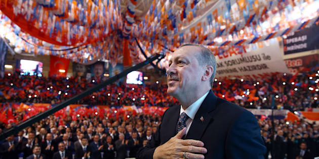 ESKISEHIR, TURKEY - FEBRUARY 17: President of Turkey and Chairman of Turkey's ruling Justice and Development (AK) Party Recep Tayyip Erdogan greets the crowd during the provincial congress of Turkey's ruling AK Party in Eskisehir, Turkey on February 17, 2018. (Photo by Kayhan Ozer/Anadolu Agency/Getty Images)
