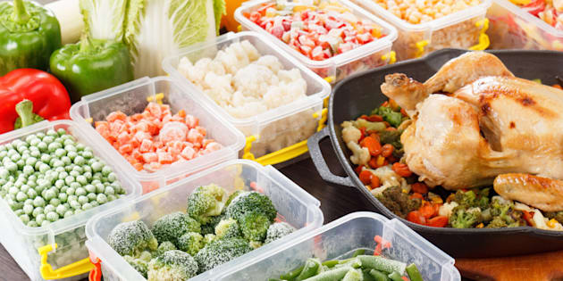 Stir fry vegetables frozen in plastic container, roasted chicken and veggies. Healthy freezer food in tray.