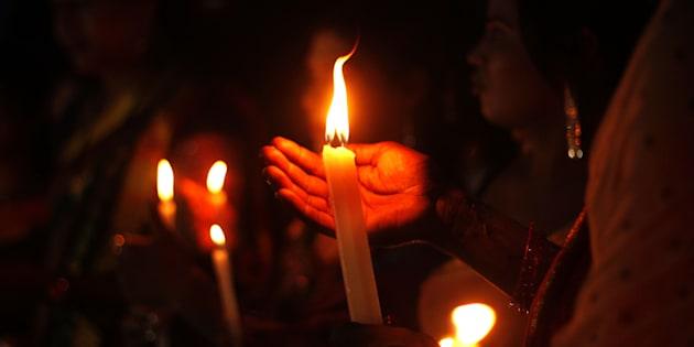 Members of the transgender community holds candle lights as they pray for soldiers killed in Uri, Kashmir.