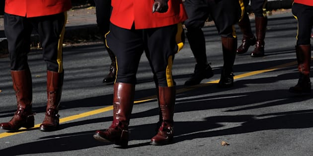 RCMP officers march during Remembrance Day ceremonies in Halifax on Nov. 11, 2017.