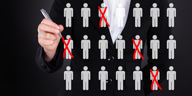 Midsection of businesswoman striking out employees representing recruitment
