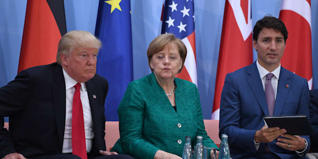 "(L-R) US President Donald Trump, German Chancellor Angela Merkel and Canada's Prime Minister Justin Trudeau attend the panel discussion ""Launch Event Women's Entrepreneur Finance Initiative"" on the second day of the G20 Summit in Hamburg, Germany, July 8, 2017.  REUTERS/Patrik STOLLARZ/Pool"