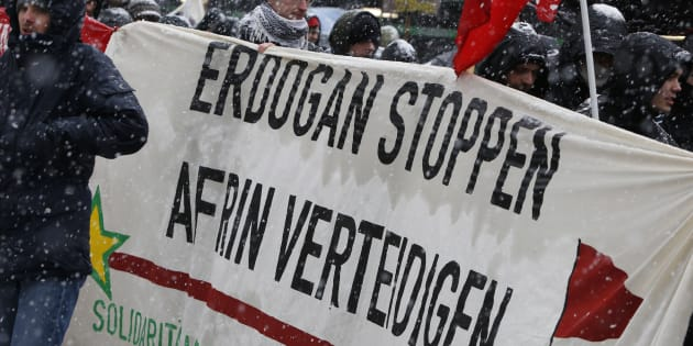 "Protesters carry a banner reading ""Stop Erdogan - defend Afrin"" at a demonstration during the Munich Security Conference in Munich, Germany, February 17, 2018. REUTERS/Michaela Rehle"