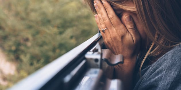 Depressed young woman in the train