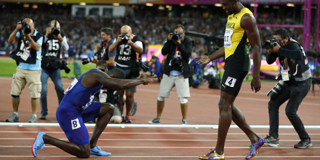 Athletics - World Athletics Championships - Men's 100 Metres Final - London Stadium, London, Britain ? August 5, 2017. Usain Bolt of Jamaica with Justin Gatlin of the U.S. after the final. REUTERS/Phil Noble
