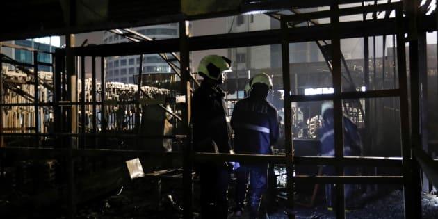 Firemen inspect the debris after a fire at a restaurant in Mumbai, India, December 29, 2017. REUTERS/ Danish Siddiqui