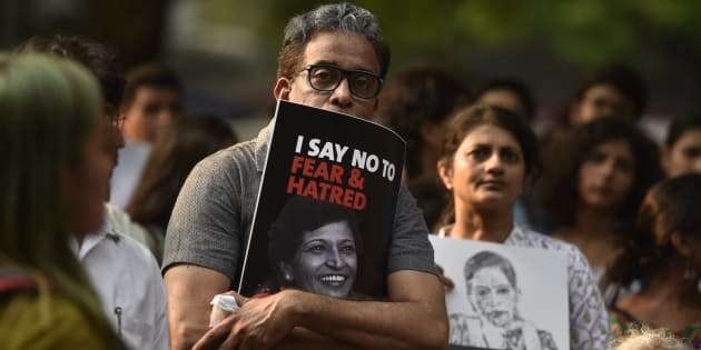 People participate in a protest called 'Not In My Name' against the killing of senior journalist Gauri Lankesh at Jantar Mantar.