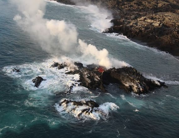 Photo: Lava forms new land off Hawaii's coast