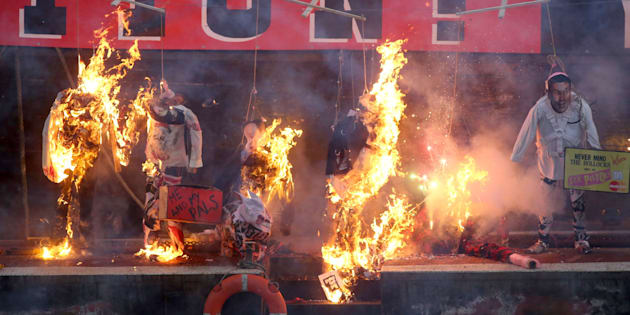 A collection of punk memorabilia belonging to Joe Corre, the son of Malcolm McLaren, the former manager of the Sex Pistols and fashion designer Vivienne Westwood, is burnt on a boat on the River Thames, in London, Britain November 26, 2016. A collection of punk music memorabilia went up in flames on Saturday in a protest meant to highlight how the genre has been subsumed into the cultural establishment. Joe Corre set fire to his collection - which he valued at 5 million pounds - of punk-era clothes and paraphernalia from the side of a boat on the River Thames, London.  Corre organised the protest to oppose a year-long festival called Punk London created to celebrate 40 years of punk culture, supported by establishment bodies like the Mayor of London, the British Council and major record label Universal Music.   REUTERS/Neil Hall