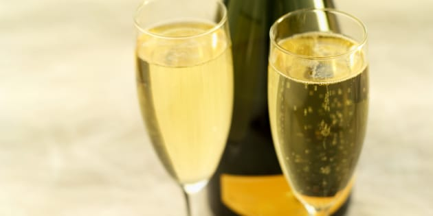 Close-up of a bottle of champagne and two glasses
