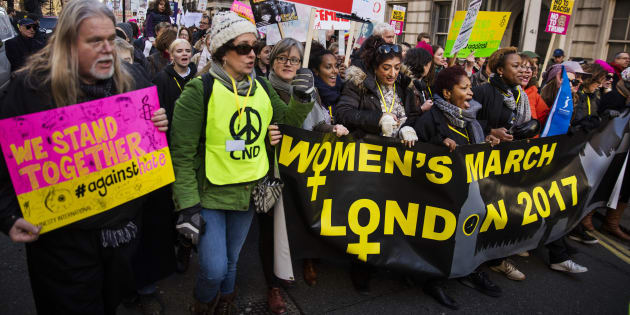 Protesters make their way through the streets of London during the Women's March onSaturday.