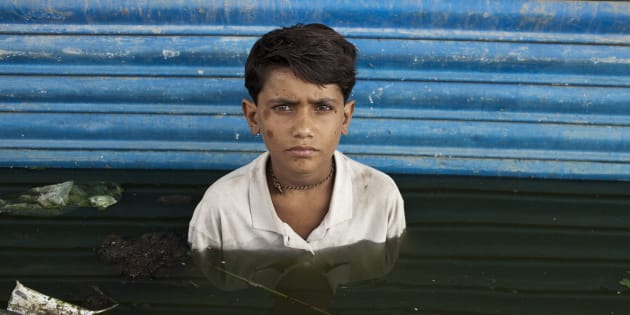 Young Asif is photographed in the town of Khairpur Nathan Shah, which was submerged by flood waters.