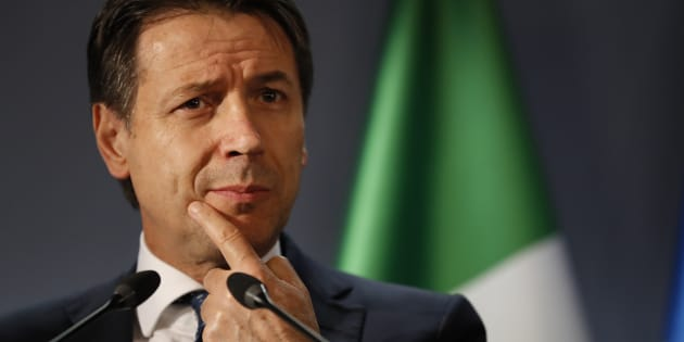 Italian Prime Minister Giuseppe Conte speaks during a media conference at the conclusion of an EU summit in Brussels, Friday, Dec. 14, 2018. European Union leaders expressed deep doubts Friday that British Prime Minister Theresa May can live up to her side of their Brexit agreement and they vowed to step up preparations for a potentially-catastrophic no-deal scenario. (AP Photo/Alastair Grant)