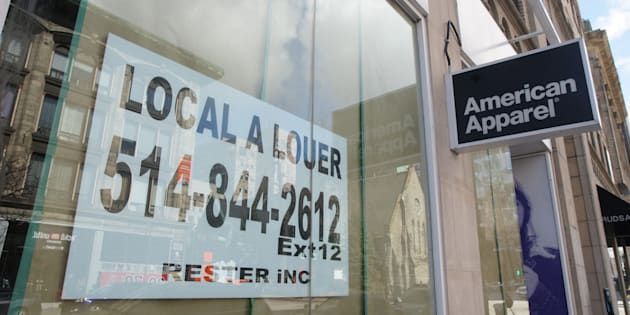 A for-rent sign in the store front window of the American Apparel store in downtown Montreal, Que. on April 18, 2017.