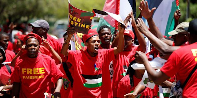 Members of South Africa's Economic Freedom Fighters party (EFF), carry placards during a march to the Israel embassy in Pretoria, South Africa, November 2, 2017.