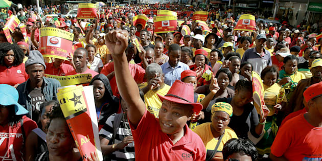 Thousands of members of Congress of South African Trade Unions (COSATU) and South African Communist Party (SACP) attend a joint 'Peoples March' in the streets of Durban city centre on April 23, 2016.
