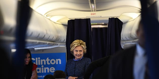US Democratic presidential nominee Hillary Clinton talks to staff onboard her campaign plane at the Westchester County Airport in White Plains, New York, on October 28, 2016.  / AFP / Jewel SAMAD        (Photo credit should read JEWEL SAMAD/AFP/Getty Images)