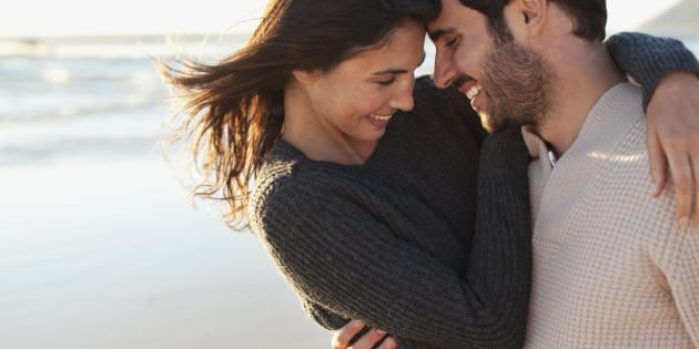 Young couple in love look each other at home in the morning