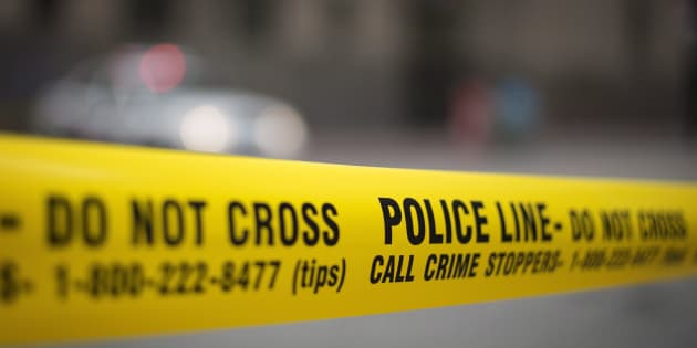 Police tape is shown in Toronto.