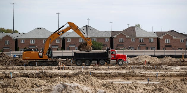 Construction workers build homes on a lot in Vaughan, a suburb with an active real estate market, in Toronto, Ont., May 24, 2017.