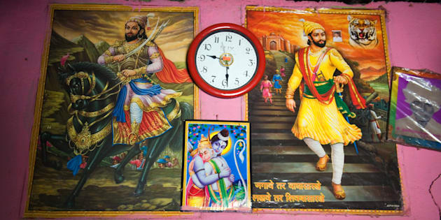 Poster of Shivaji and Ram Hugging Hanuman on the wall interior village Salunkhewadi, near Ghat Nandur, Marathwada Mharashtra India Southeast Asia