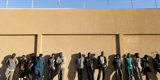 Migrants stand in a detention centre run by the interior ministry of Libya's eastern-based government, in Benghazi, Libya, December 13, 2017. REUTERS/Esam Omran Al-Fetori
