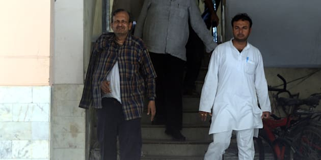 DELHI, INDIA JULY 20: Corporate affairs director general BK Bansal,(L) whose wife and daughter allegedly committed suicide, was arrested by the CBI last weekend in East Delhi.(Photo by India Today Group/Getty Images/India Today Group/Getty Images)