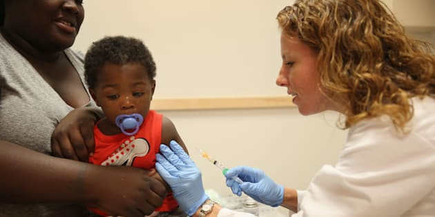 India Ampah holds her son, Keon Lockhart, 12 months old, as pediatrician Amanda Porro M.D. administers a measles vaccination during a visit to the Miami Children's Hospital on June 02, 2014 in Miami, Florida.